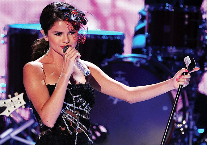 Selena Gomez performs onstage using Audio-Technica's 5000 Series UHF Wireless System and AEW-T3300a handheld transmitter during the 2011 Teen Choice Awards held at the Gibson Amphitheatre on August 7, 2011, in Universal City, California.